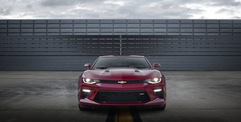 The 2016 Chevrolet Camaro SS features an aerodynamically optimized design, with hood vents that channel air that passes through the grille and radiator out and over the top of the car, reducing front-end lift.
