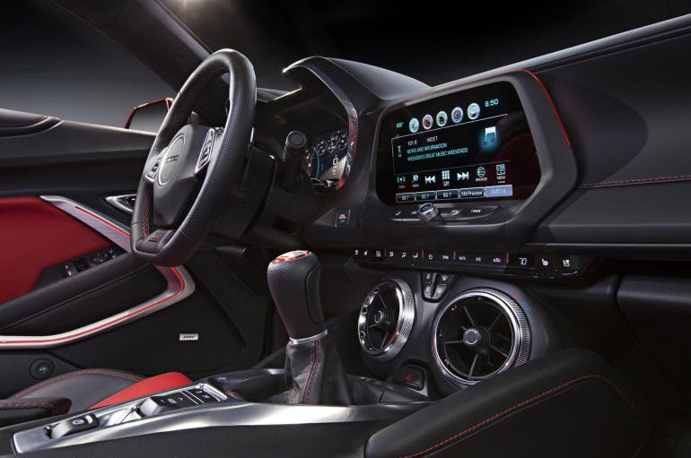 An all-new, driver-focused interior in the 2016 Chevrolet Camaro features performance-optimized ergonomics, including new seats, a new, flat-bottom steering wheel and a new center console designed for easier manual-transmission shifting.