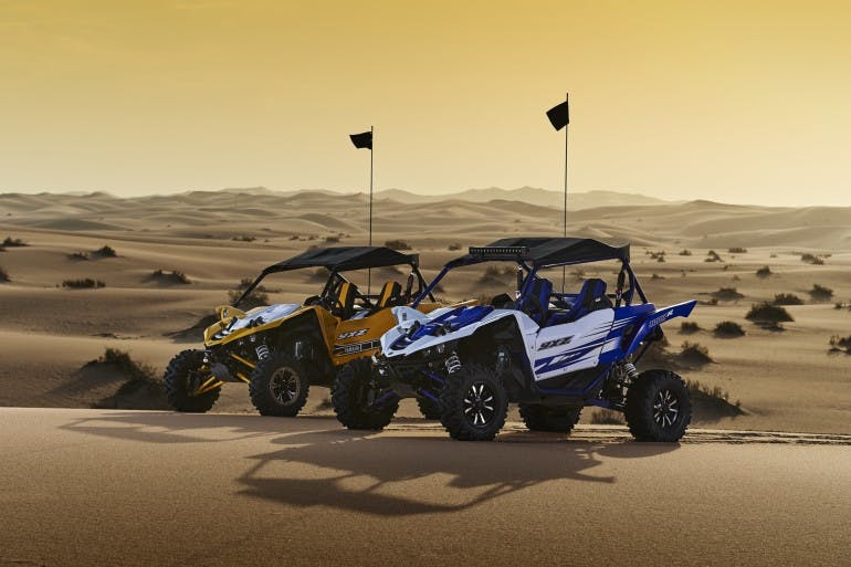 YXZ1000R Racing Blue as depicted is equipped with genuine Yamaha accessories.